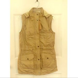Fur lined vest with removable hood